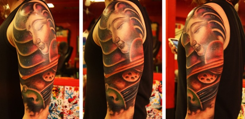 Charming Black And Red Color Ink Half Sleeve Buddha Tattoo Design On Shoulder For Boys