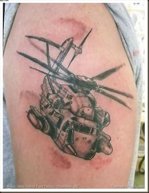 Charming Black Color Ink Army Helicopter Tattoo On Biceps For Boys
