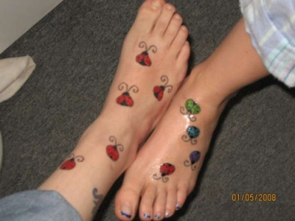 Charming Green Blue Black And Red Color Ink Leg Bug Similar Tattoo For Couple