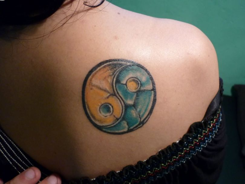 Coolest Yin Yang Tattoo On Back Shoulder With Colorful Ink