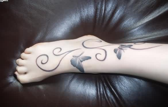 Coolest black Color Ink Butterfly Ankle Tattoo Designs For Girls On Foot
