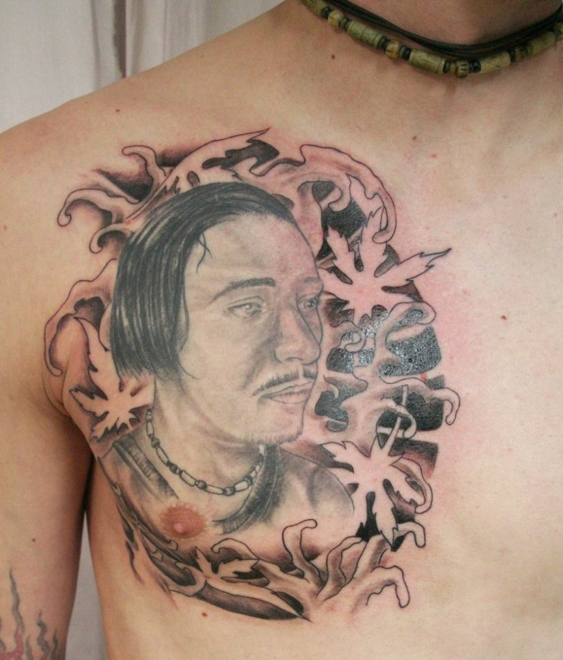 Crazy Black Red And Brown Color Ink Asian Man Face Tattoo On Chest For Boys