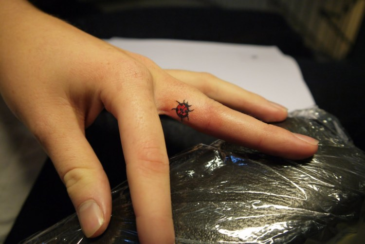 Custom Black And Red Color Ink Lady Bug Tattoo On Middle Finger For Girls