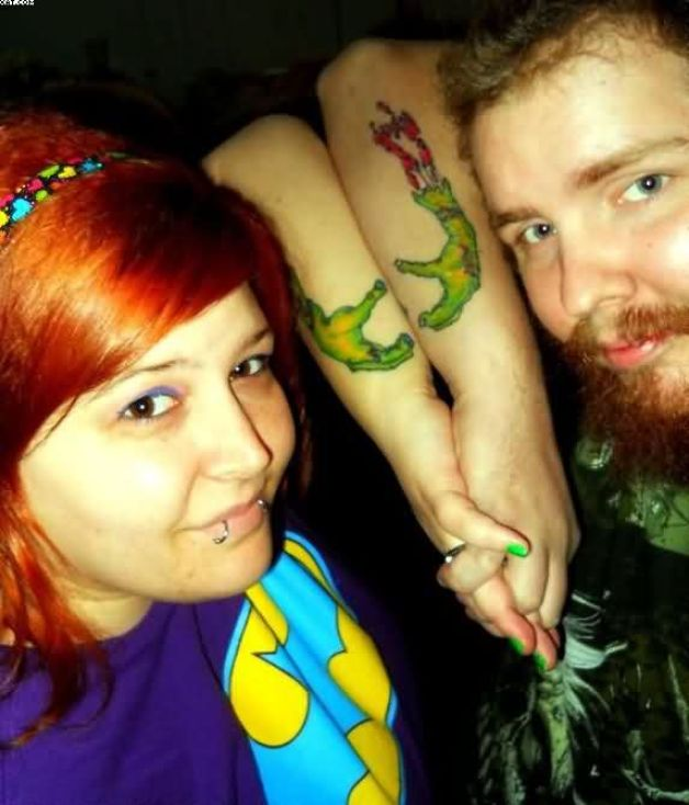 Cute Couple Having Zombie Hands Tattoos