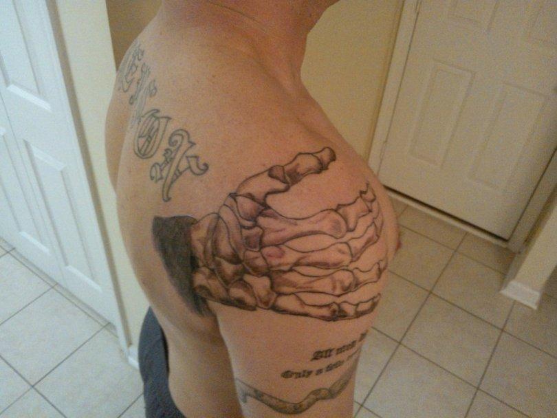 Elegant Black And Red Color Ink Hand Of Death Tattoo On Shoulder For Boys