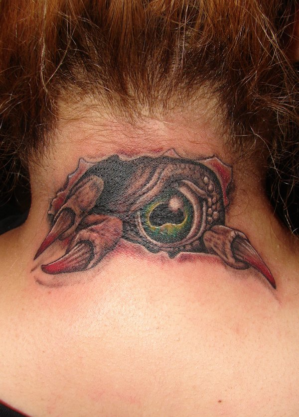 Elegant Red Green And Black Color Ink Demon Eye Tattoo On Back Neck For Girls