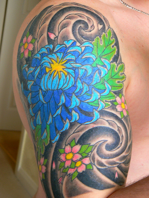 Extremely Blue Green Red And Black Color Ink Chrysanthemum Tattoo On Shoulder For Girls