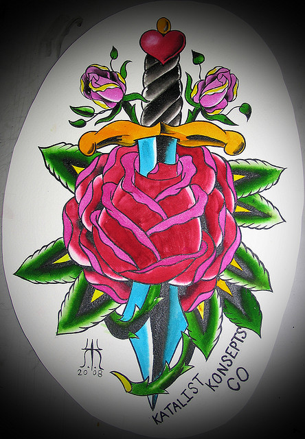 Fabulous Green Blue Red And Black Color Ink Rose Dagger Tattoo Design For Girls