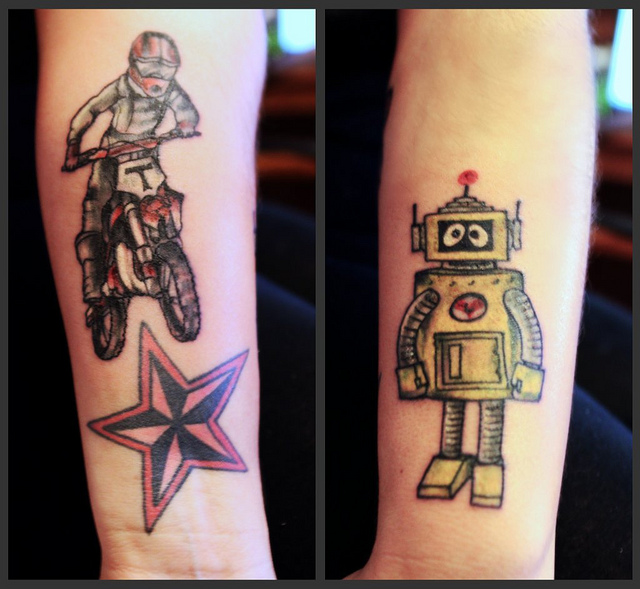 Fabulous Red Yellow And Black Color Ink Bike Nautical Star & Robot Tattoo For Girls