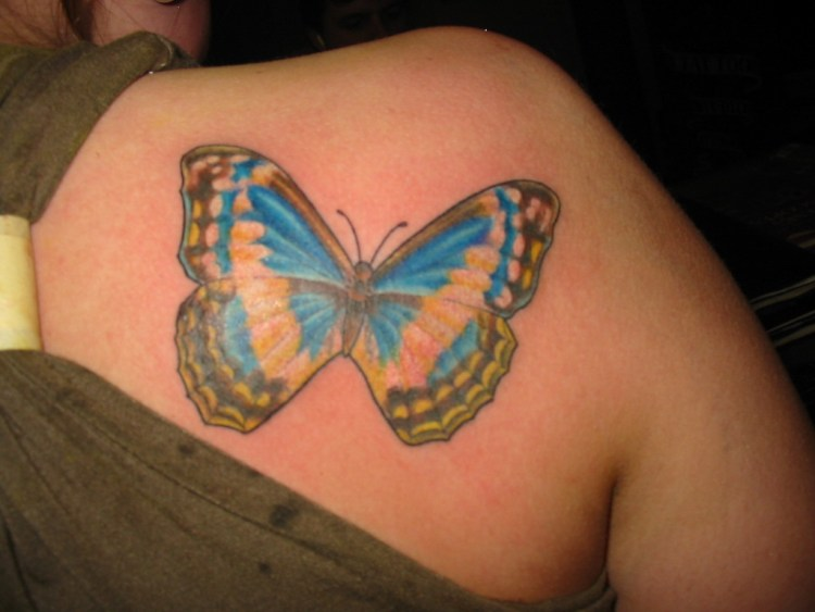 Famous Blue Green And Black Color Ink Butterfly Tattoo On Back Shoulder For Girls Only