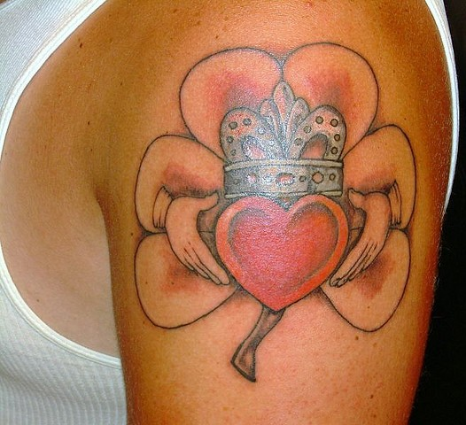 Famous Red And Black Color Ink Shamrock With Claddagh Tattoo On Upper Arm For Boys