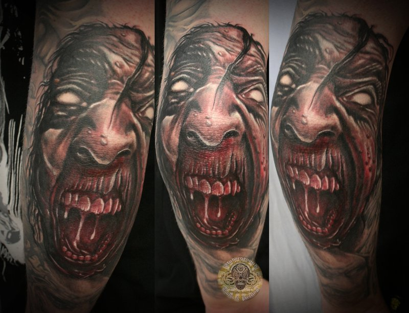 Fantastic Red And Black Color Ink Crawling Demon Face Tattoo Design For Boys