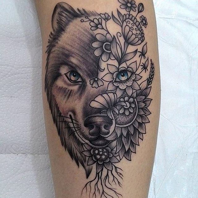 Fantastic Wolf Tattoo With Flower On Calf For Guys