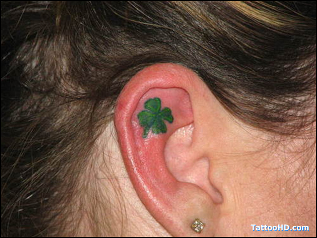 Great Black And Green Color Ink Clover Tattoo In Ear For Girls