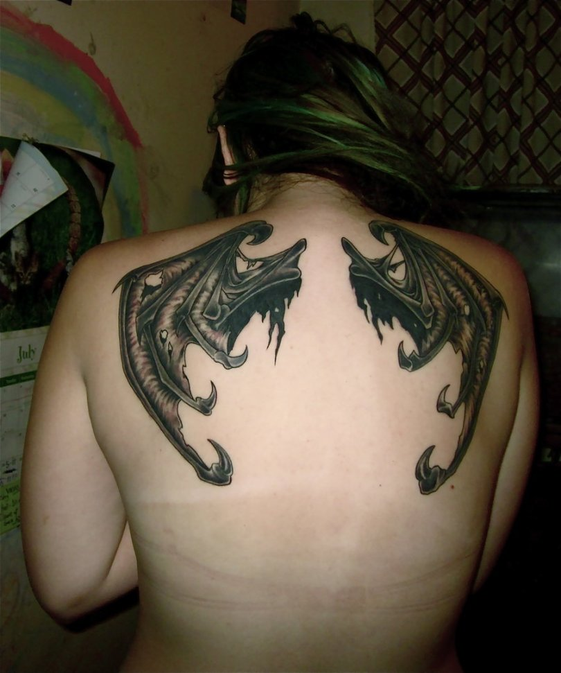 Great Black And Red Light Color Ink Bat Wings Tattoo On Upper Back For Girls