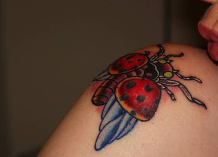 Great Blue Black And Red Color Ink Lady Bug Tattoo Design On Shoulder For Girls