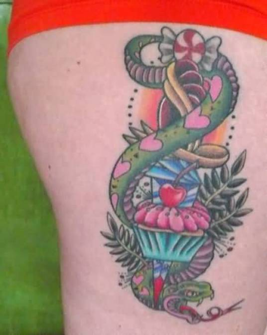 Great Green Blue Black And Red Color Ink Snake With Cup Cake Tattoo On Thigh For Girls