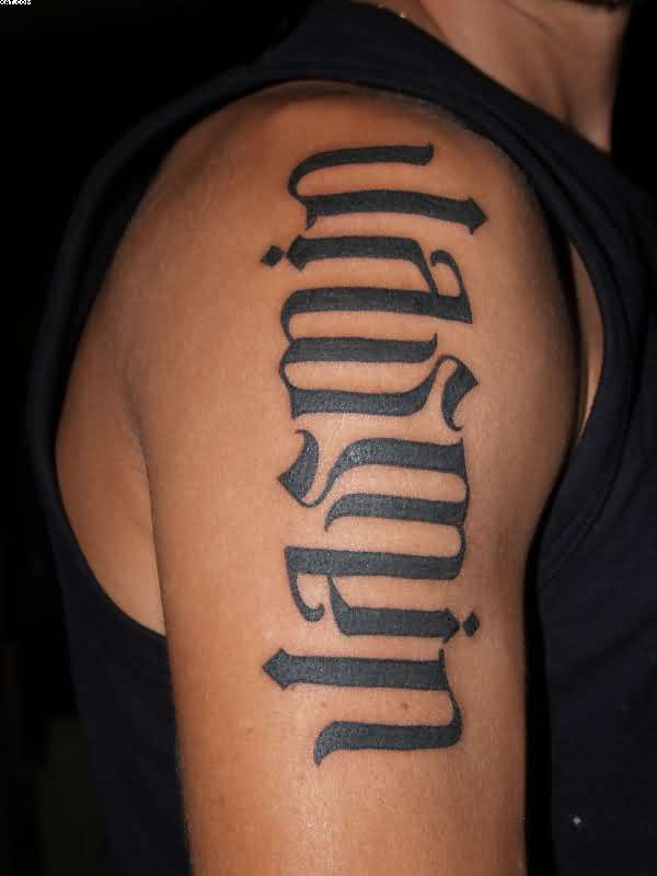 Groovy Black Color Ink Ambigram Tattoo On Arm For Boys