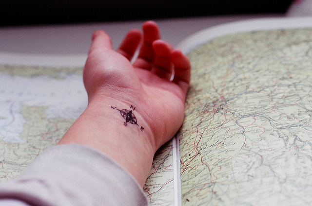 Groovy Black Color Ink Compass Tattoo On Wrist For Girls