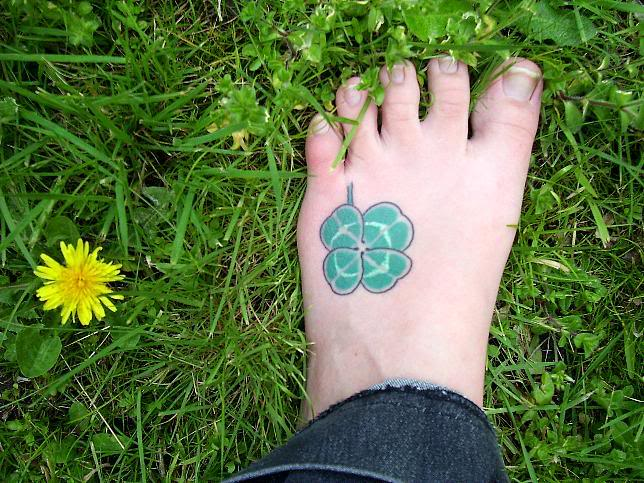 Horrible Black And Green Color Ink Clover Tattoo For Foot For Girls