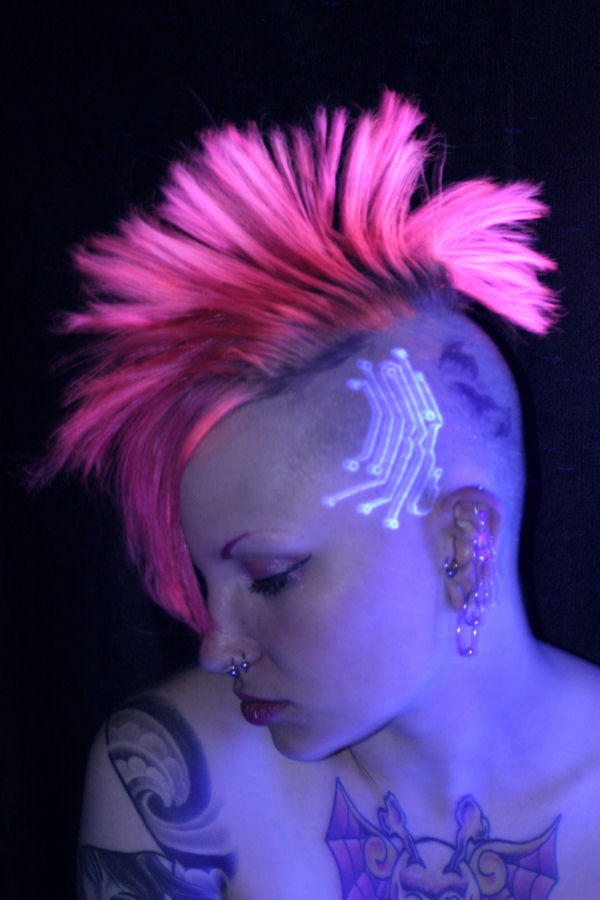 Horrible Red And Green Color Light Blacklight Tattoo Design On Head For Girls