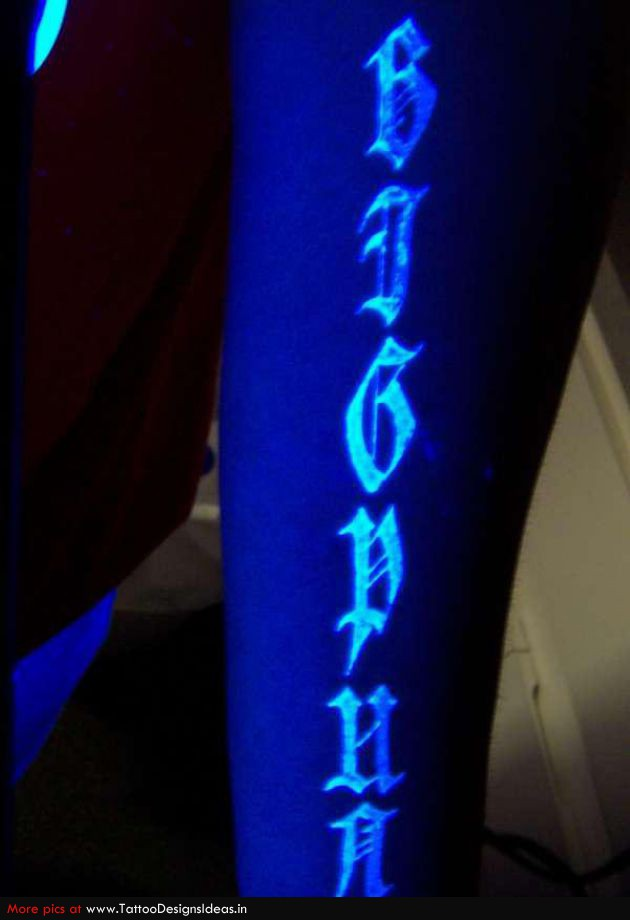 Impressive Blue And Green Color Light Blacklight Text Tattoo Design On Arm For Girls