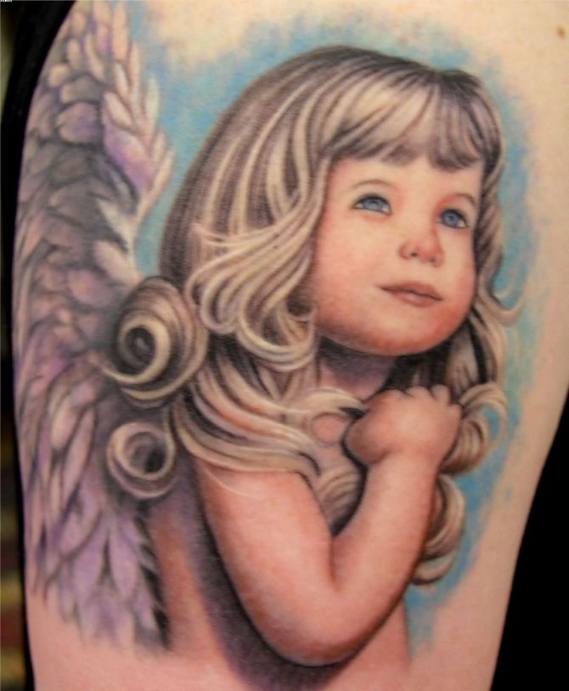 Incredible Arm Tattoo Of A Baby For Women