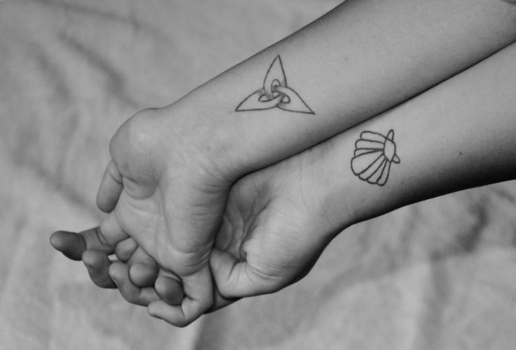 Incredible Black And White Wrist Tattoos Of Shell And Triangle With Black Ink