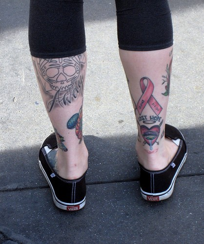 Incredible Blue Black And Red Color Ink Back Leg Breast Cancer Tattoo Design For Girls