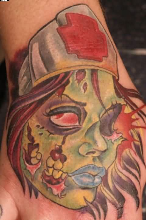 Incredible Crazy Zombie Girl Head Tattoo On Hand