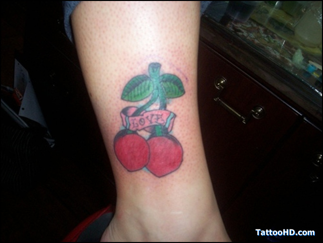 Incredible Green And Red Color Ink Love Cherry Tattoo Design On Arm For Girls