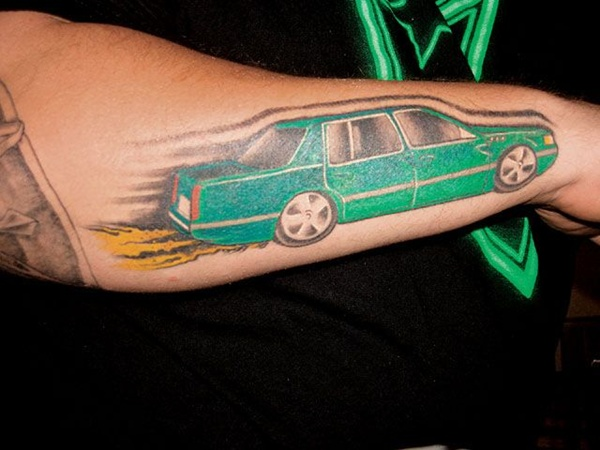 Incredible Green Black And Red Color Ink Car Tattoo Design On Arm For Boys