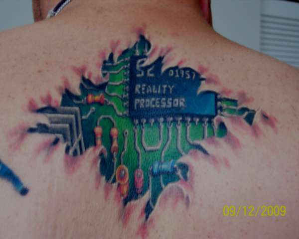 Incredible Green Blue And Black Color Ink Chip Plate Tattoo On Upper Back For Boys