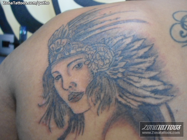 Innovative Black And Blue Color Ink Aztec Girl Tattoo On Back Of Shoulder For Boys