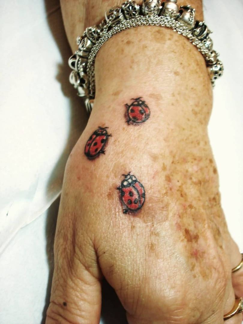 Innovative Black And Red Color Ink Three Lady Bugs Tattoo On Hand For Boys