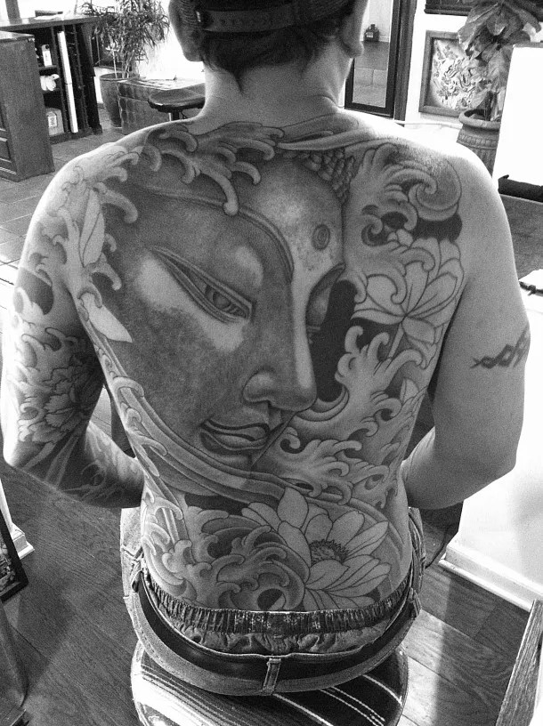 Innovatve Black And White Color Big Buddha Head Tattoo Design On Back For Boys