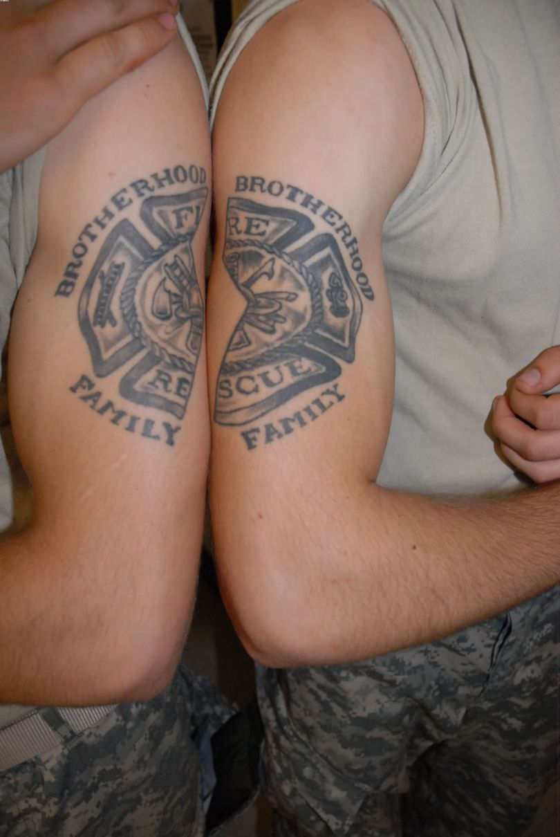 Inspirational Black Color Ink Army Fire Fighter Tattoo On Muscles For Boys