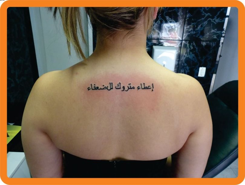 Inspiring Grey Color Ink Arabic Tattoo On Upper Back For Girls