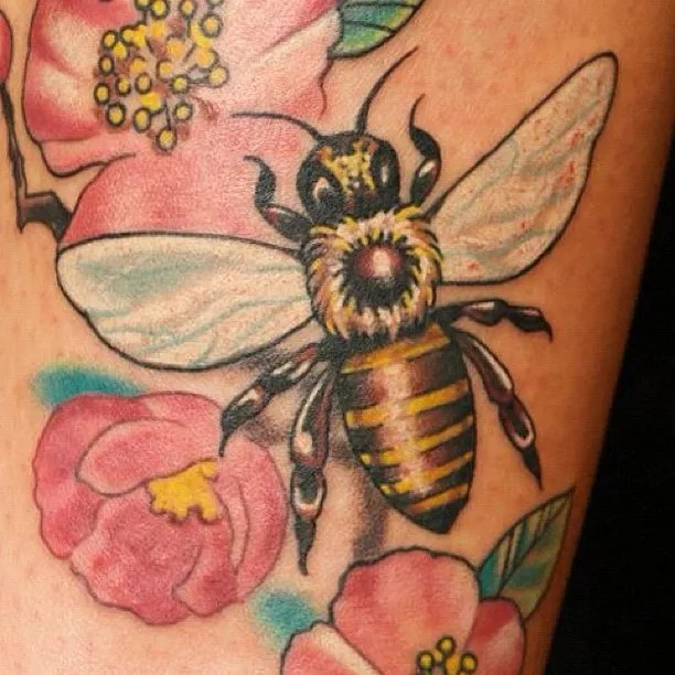 Latest Red Green Black And Yellow Color Ink Bumblebee With Flowers Tattoo Design For Girls On Leg
