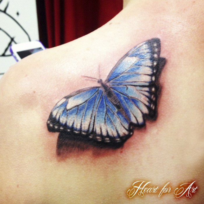 Lovely Black And Blue Color Ink Butterfly Tattoo Design On Back For Girls