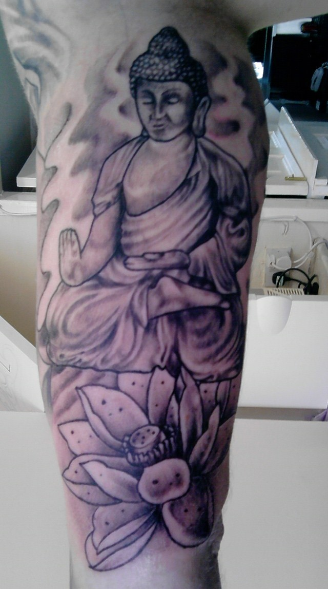 Lovely Black And Red Color Ink Buddha & Lotus Tattoo Design On Leg For Boys