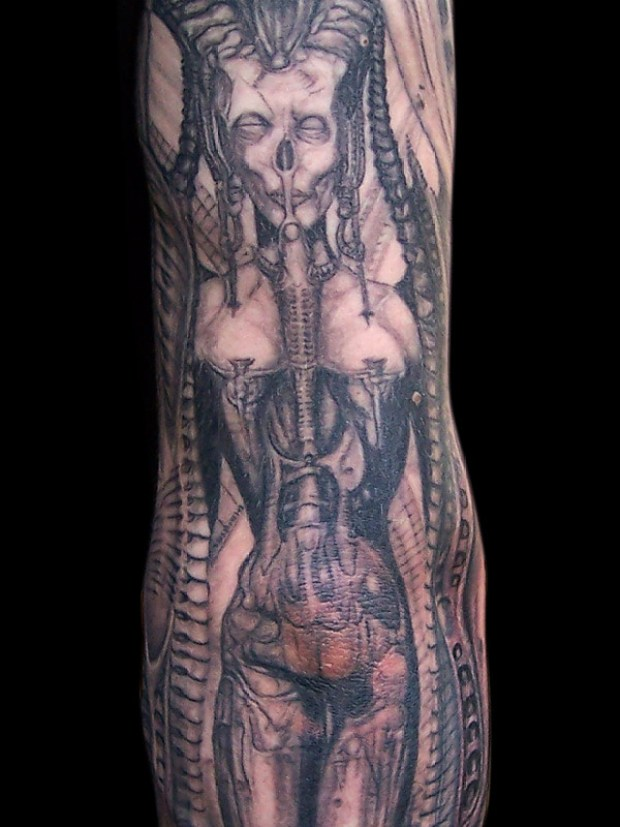 Lovely Grey Color Ink Biomechanical Giger Tattoo On Arm For Boys