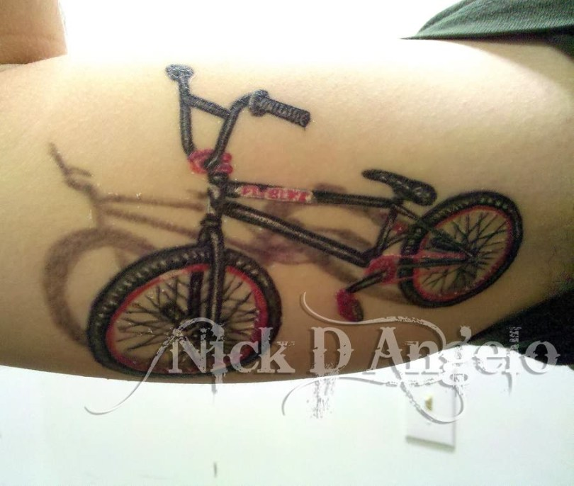 Lovely Red And Black Color Ink Bike Tattoo Design On Arm For Girls