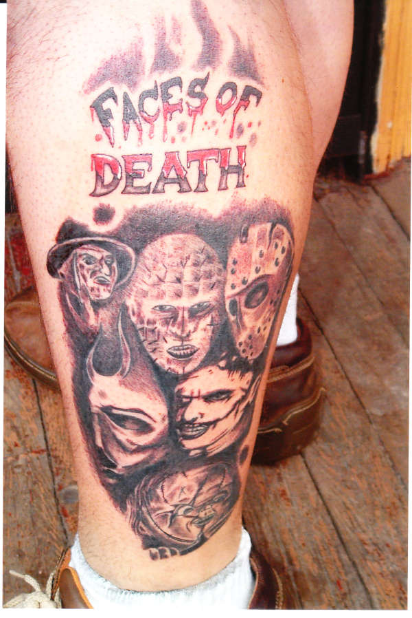 Maori Black And Red Color Ink Faces Of Death Tattoo Designs On Legs For Boys