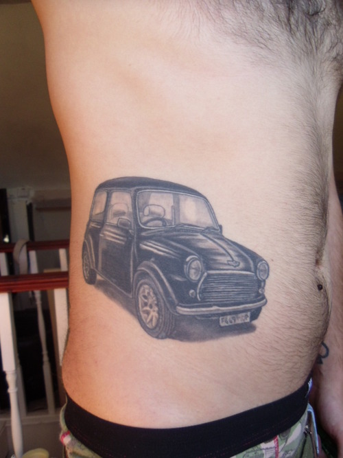 Maori Black Color Ink Car Tattoo On Rib Side For Boys