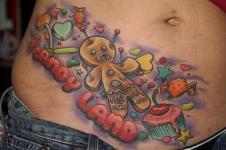 Maori Black Green Blue And Red Color Ink Candy Land Tattoo On Belly For Girls