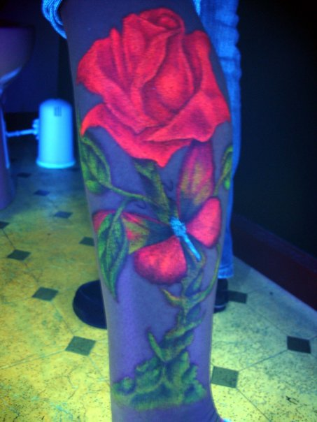 Marvel Red And Green Color Blacklight Rose & Butterfly Tattoo On Arm For Girls
