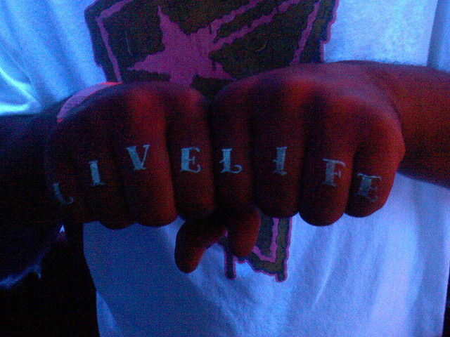 Marvelous Blue Color Ink Live Life Blacklight Tattoo On Fingers For Boys