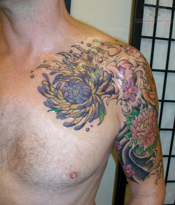 Marvelous Green Blue Red And Black Color Ink Chrysanthemum Shoulder Tattoo For Boys