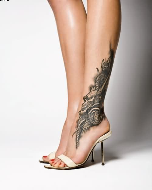 Mind Blowing Black Color Ink Angel Tattoo On Ankle For Girls